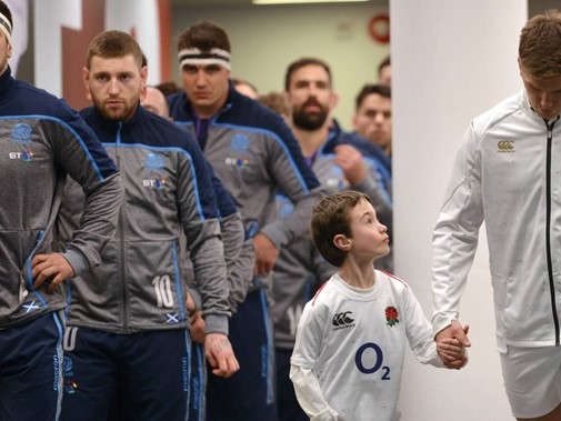 Dr Fairweather's son leads the England rugby team captain Owen Farrell out to a game against Scotland